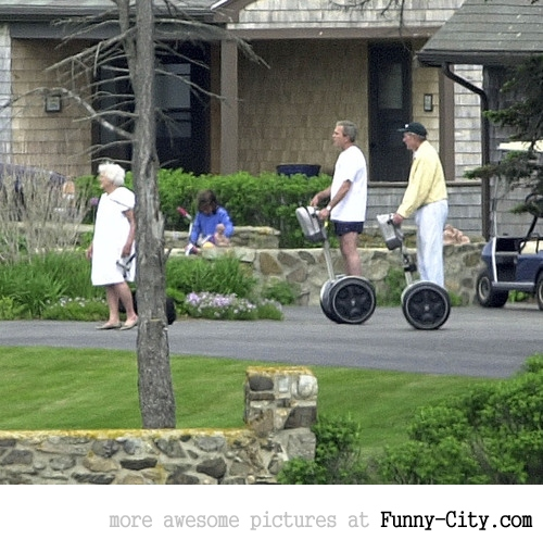 George W. Bush and his father chase Barbara Bush on segways [5282]