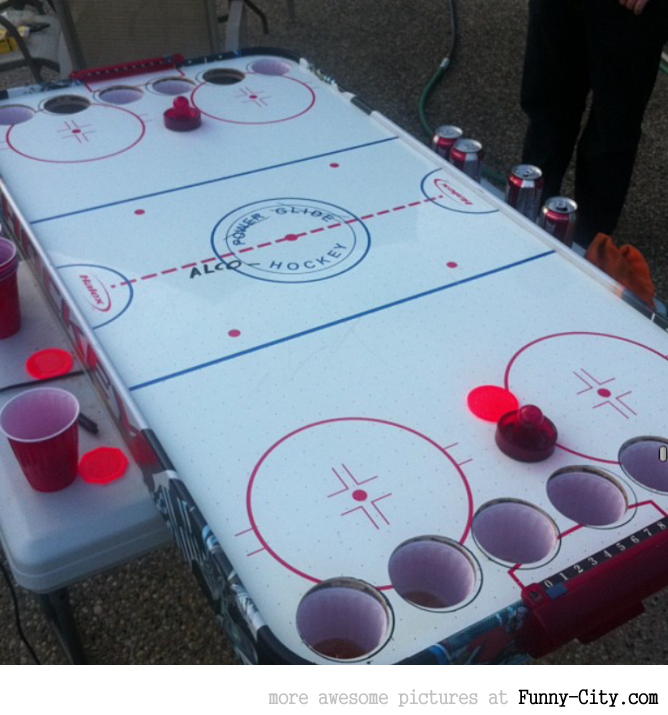Alcohockey - the Canadian variation of beer pong.