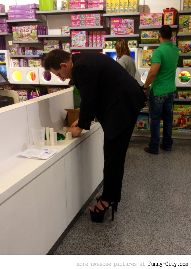 Just your average businessman wearing hooker heels in the Lego store. [6568]