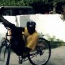 Great Senegalese does bike tricks with an old bike