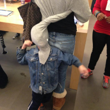 Bored kid at an Apple Store.